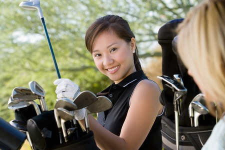 opting: Golfer Selecting Club From Bag LANG_EVOIMAGES