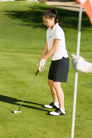 beforehand: Golfer Preparing to Sink Putt LANG_EVOIMAGES