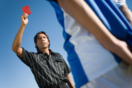 decisionmaking: Referee Ejecting Soccer Player from Game