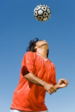Soccer Player Heading Ball Stock Photo