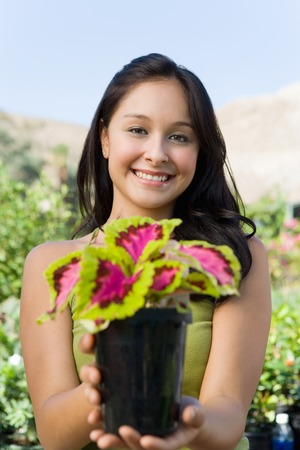 Young Woman with Plant Stock Photo - 5436096