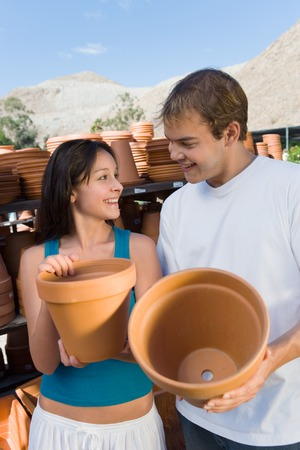 nurseries: Couple Buying Clay Pots for Plants