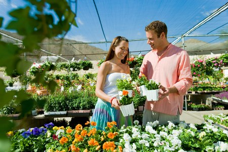thirtysomething: Happy Couple Shopping at Greenhouse Together LANG_EVOIMAGES