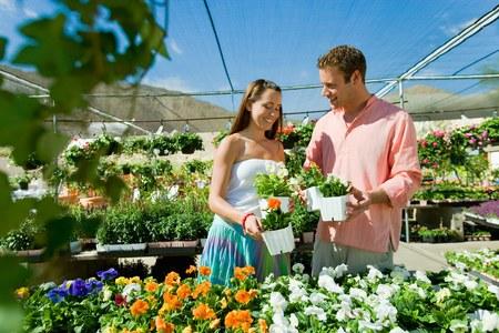 twentysomething: Happy Couple Shopping at Greenhouse Together LANG_EVOIMAGES