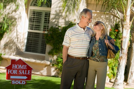 New Homeowners in Front Yard Stock Photo - 5436117
