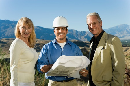 Home Builder with Couple Building New Home Stock Photo - 5436120