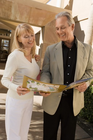Couple Looking at Real Estate Brochure Stock Photo - 5436125