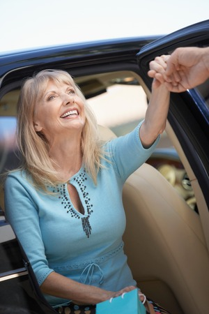 getting out: Woman Getting out of Car