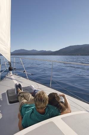 twentysomething: Couple Sitting on Deck of Sailboat LANG_EVOIMAGES