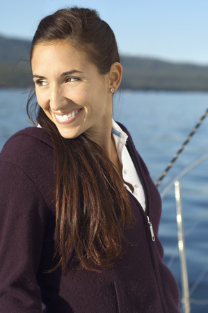 thirtysomething: Woman on Sailboat Looking to Horizon LANG_EVOIMAGES