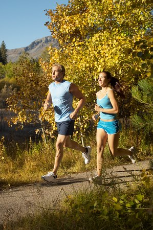 late fall: Jogging Couple on Scenic Path