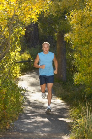 Jogger on Wooded Path in Park Stock Photo - 5436173