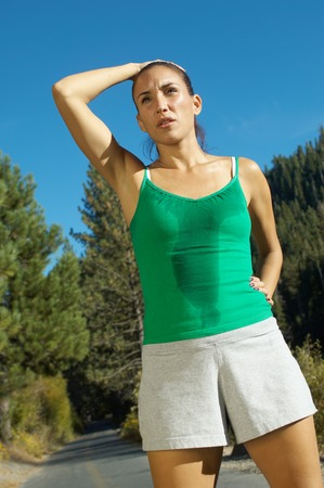perspiration: Jogger Catching Her Breath LANG_EVOIMAGES