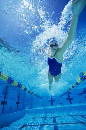 only young adults: Young Woman Swimming in Pool