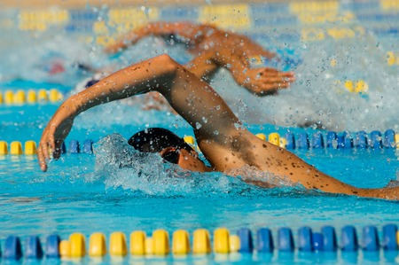 swimming competition: Swimmers Racing LANG_EVOIMAGES
