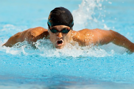 exerting: Competitive Swimmer LANG_EVOIMAGES
