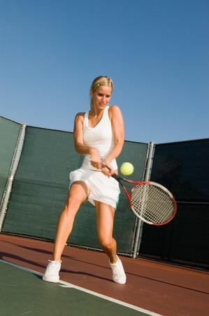athletic gear: Tennis Player Hitting Backhand