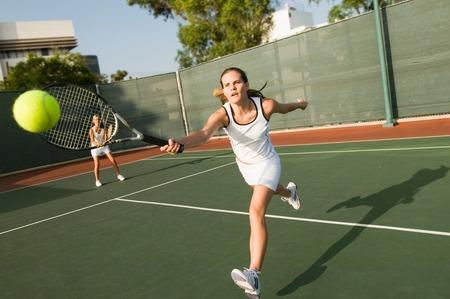 willpower: Tennis Player Reaching For Ball