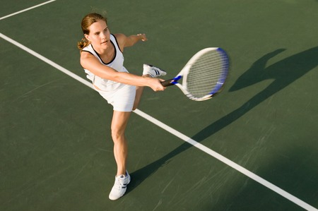 sporting activity: Tennis Player Hitting Forehand