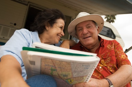 early sixties: Couple Planning Their Next Journey