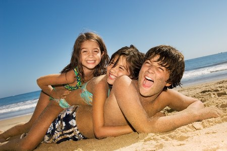 Kids Playing on the Beach Stock Photo - 5436295