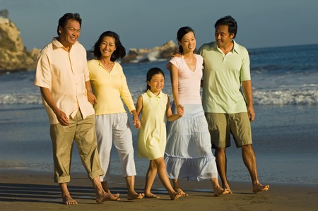 Family Walking on Beach Stock Photo - 5436305