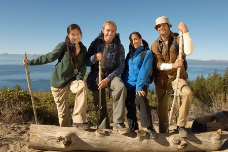 racially diverse: Friends Hiking on Coastline