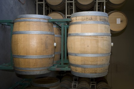 the ageing process: Wine barrels in winery LANG_EVOIMAGES