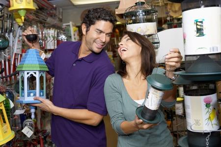 alternative living: Couple Choosing Outdoor Lanterns