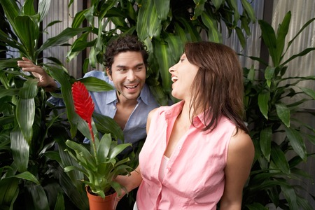 Playful Couple at a Plant Nursery Stock Photo - 5438088