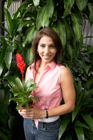 Woman with Potted Tropical Plant Stock Photo - 5438089