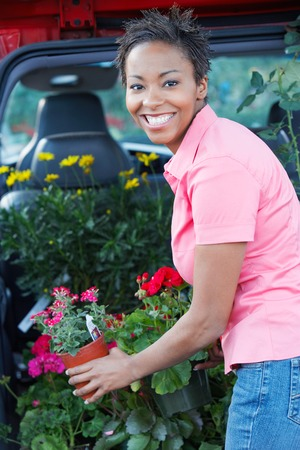 Woman Loading Her Potted Plants into Trunk of Car Stock Photo - 5438093