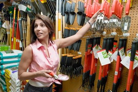decisionmaking: Woman Choosing Garden Tools LANG_EVOIMAGES