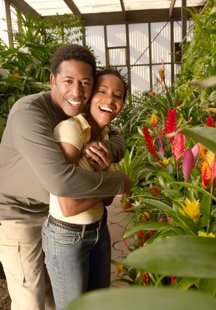 living being: Happy Couple Choosing Plants at a Nursery