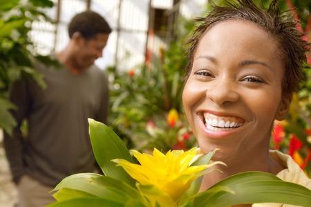 kassen: Smiling Woman in een kas