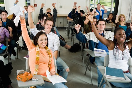 racially diverse: Students Raising Hands in Classroom LANG_EVOIMAGES