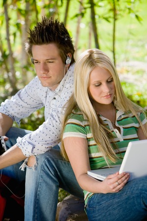 Young Couple Relaxing Outside Stock Photo - 5438132