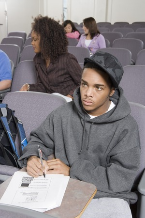 University student writing in lecture hall Stock Photo - 5438141
