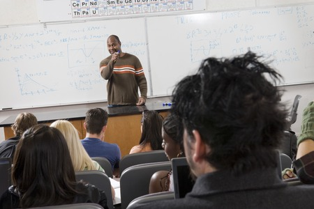 Lecturer teaching University students in classroom Stock Photo - 5438148