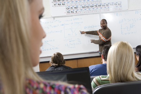 Lecturer teaching University students in classroom Stock Photo - 5438150