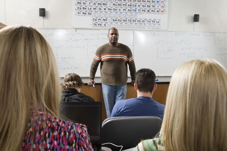 Lecturer teaching University students in classroom Stock Photo - 5438151