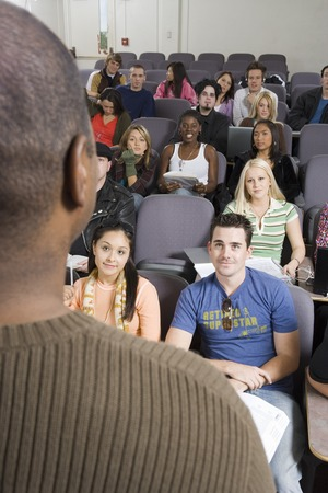 Lecturer teaching University students in lecture hall Stock Photo - 5438153