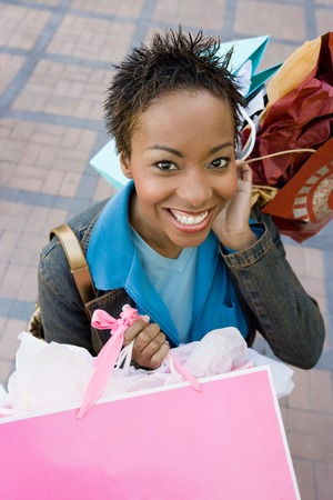 Young Woman after Shopping Spree Stock Photo - 5438223