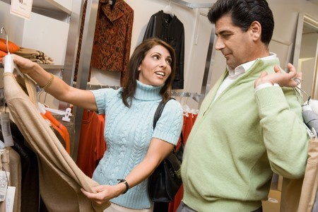 thirtysomething: Patient Man Clothes Shopping with Woman