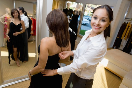 salespeople: Salesperson Assisting Woman with Cocktail Dress LANG_EVOIMAGES
