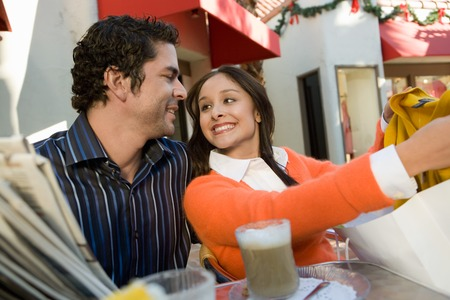 Woman Showing Man Her Purchase Stock Photo - 5404631