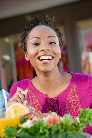 Smiling Woman Having a Salad Stock Photo - 5404628
