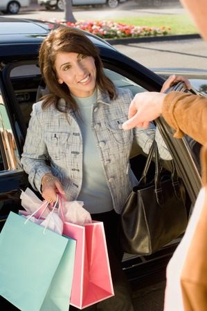 Woman with Shopping Bags Getting out of Car Stock Photo - 5404552