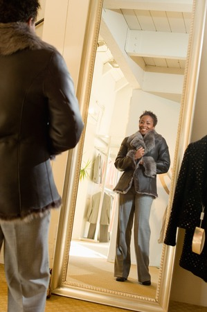 full length mirror: Woman Trying on Coat in Boutique