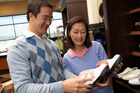 decisionmaking: Couple in a Golf Shop